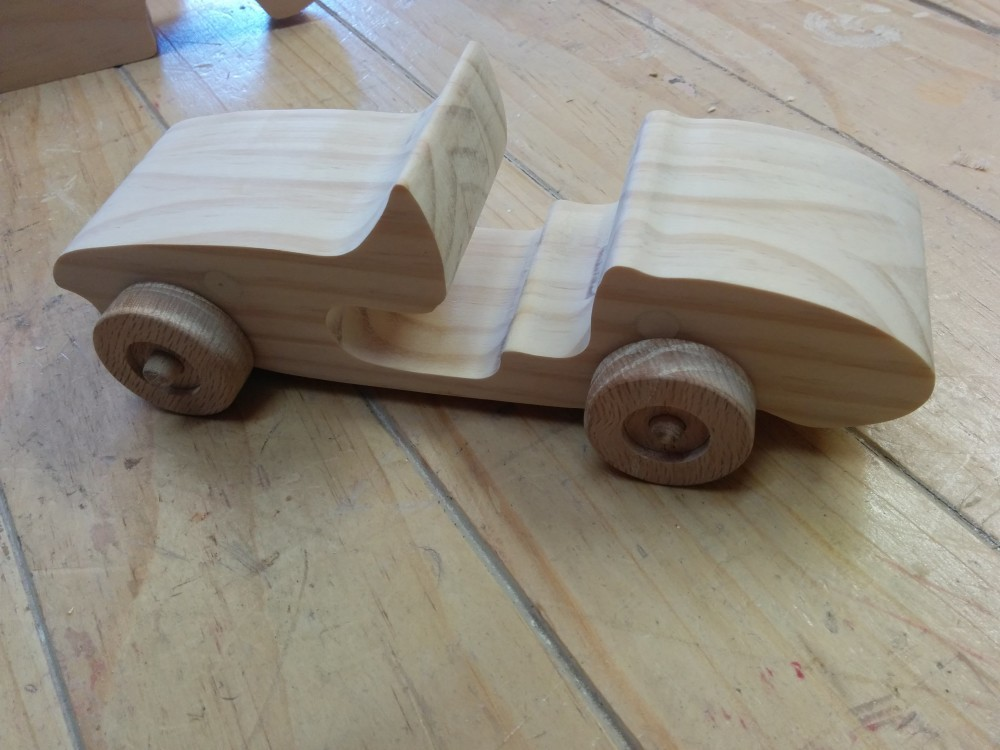 Car body with wheels attached